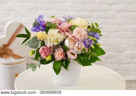 Fresh Flowers In Box, Beautiful Flower Arrangement On Table. Floral Gift For Holiday Celebration. Fl