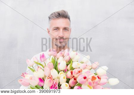 Happy Womens Day. For Someone Special. Man With Tulips Bouquet. Handsome Guy Holding Pink Flowers. A