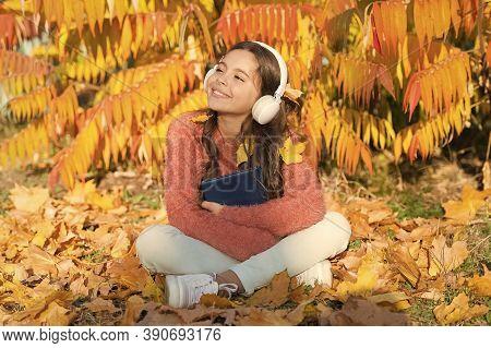 Audio Library. Small Girl Listen To Audio Book In Headphones. Cute Kid In Stereo Earphones Sit On Au