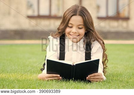 Extracurricular Reading. Cute Small Child Reading Book Outdoors. Adorable Little Girl Learn Reading.