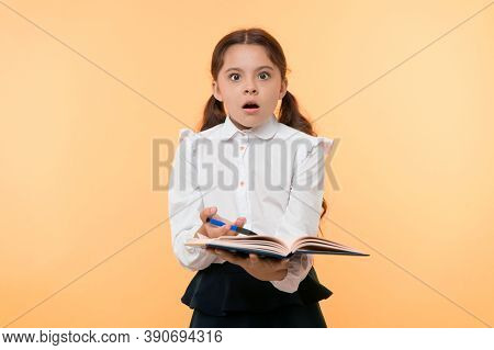 Girl Cute Schoolgirl In Uniform Hold Book With Information Yellow Background. Pupil Get Information