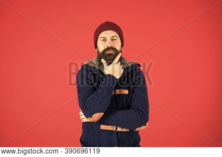 Winter Menswear. Man Bearded Warm Jumper And Hat Red Background. Winter Season Menswear. Personal St