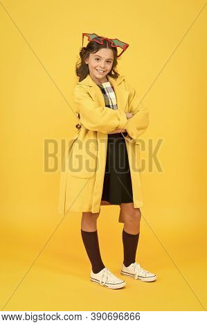 Enjoy Confidence. Confident School Child Yellow Background. Happy Girl With Confident Smile. Small K