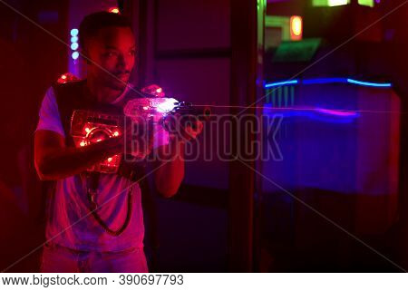 Laser Tag Player Holding Gun In Amusement Center Playing Game