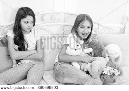 Kids Play Toys In Bed. Little Girls Spend Time Together. Friendship Sisterhood Personal Relations. T