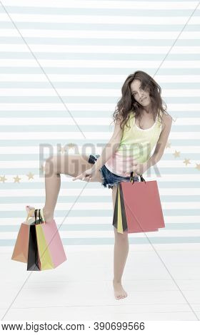 Shopping Advert. Funny Girl Advertising Shopping Sale. Funny Girl Pointing On Papaerbags. Advert Of