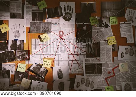 Detective Board With Fingerprints, Photos, Map And Clues Connected By Red String