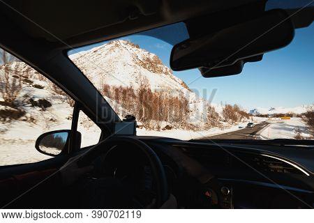 Roadtrip - Man Hands On The Wheel And Norwegian Mountains.  Lofoten Islands. Norway.