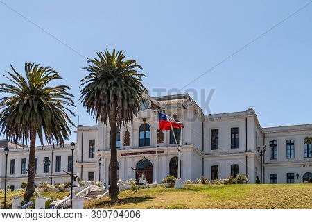 Valparaiso, Chile - December 8, 2008: White Historic Building Of Navy Headquarters On Green Lawn Hil