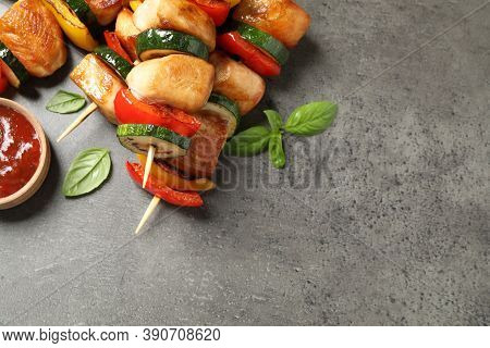 Delicious Chicken Shish Kebabs With Vegetables On Grey Table, Closeup