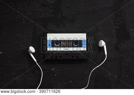 Blue -white Audio Cassette And Cassette Pleer With Headphones On A White Background. Party 90s Conce