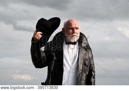 Attractive Serious Trendy Middle-aged Man. Fashion Vogue Senior Men. Stylish And Fashion Bearded Age