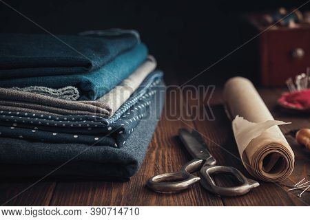 Stack Of Fabrics For Sewing  And Sewing Items - Tailoring Scissors, Including Pins, Cutting Knife, P