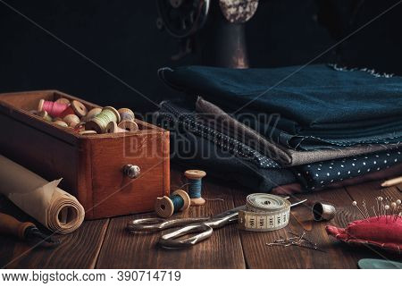 Wooden Box Of Spools Of Thread, Stack Of Fabrics And Sewing Items - Tailoring Scissors, Cutting Knif