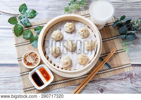 Steamed Xiaolongbao Served In A Traditional Steaming Basket (top View)