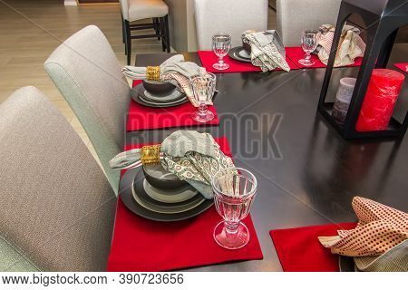 Colorful Place Mats & Place Settings On Dining Table