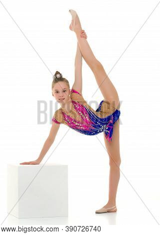 Gymnast Girl Doing Vertical Splits, Holding Her Leg With Her Hand Performing Gymnastics Element, Ful