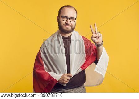 Closeup Portrait Of A Belorussian Man In Studio With A National White Red White Flag And Victory Sig