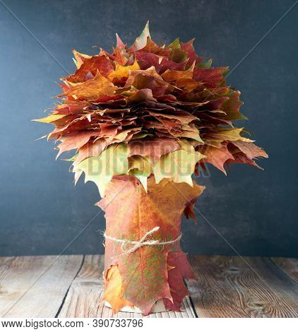 Bouquet Or Bunch Made From Colorful Autumn Leaves Isolated On Wooden Background. Autumn, Fall, Thank