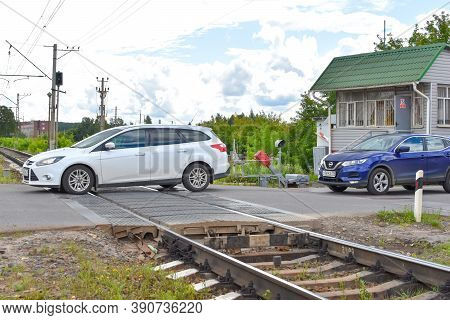 Moscow. Russia. October 2020. Car Is Crossing A Railway Crossing. Dangerous Intersection With Railro