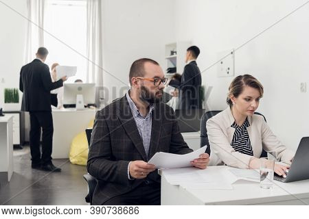 An Experienced Senior Manager Explains The Nuances Of Their Work To A New Employee. Hints, Tips, And