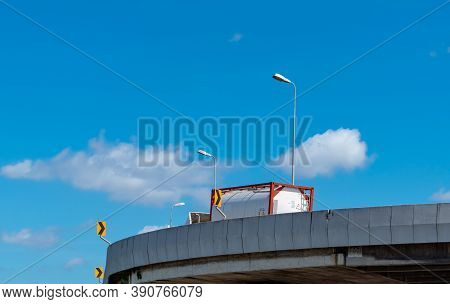 Truck Transport Logistics. Elevated Concrete Highway Road. Truck With Tank On The Road Delivery Fuel