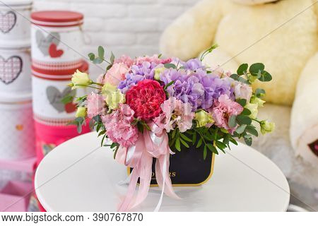 Colorful Cute Fresh Flowers Composition On Table. Fresh Bright Flowers Bouquet Gift. Flower Box Cata