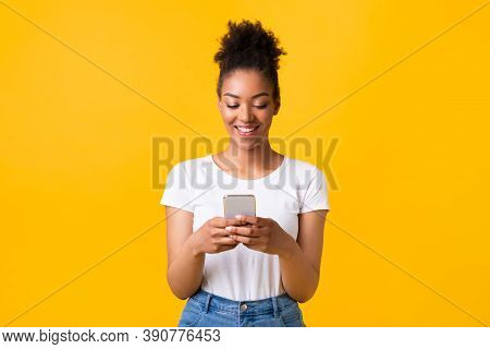People, Technology And Communication Concept. Portrait Of Beautiful Black Lady Texting On Her Cell P