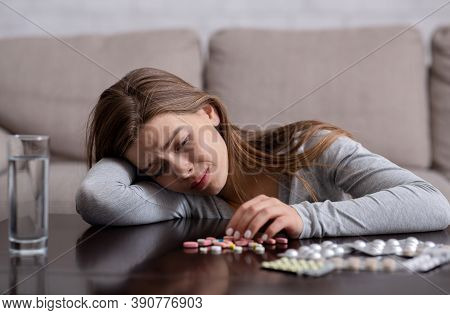 Depressed Millennial Woman Committing Suicide By Overdosing On Sleeping Pills, Indoors. Young Lady W