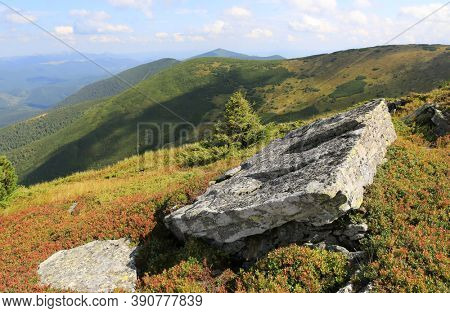 old stone on mountain top over valley in ukrainian Carpathians