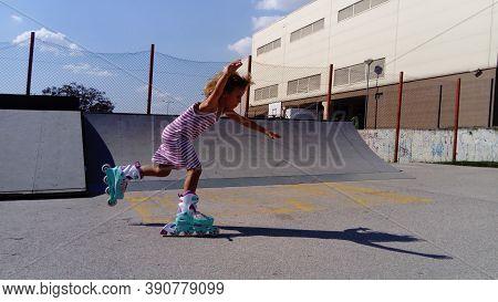 Sremska Mitrovica, Serbia, September 12, 2020. The Girl Is Rollerblading On The Asphalt. A 7-year-ol