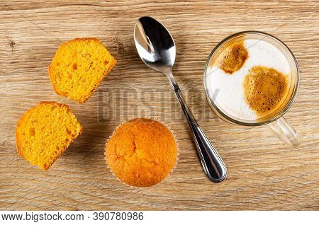 Two Halves Of Orange Muffin, Whole Muffin, Teaspoon, Transparent Glass Cup With Latte-macchiato On W