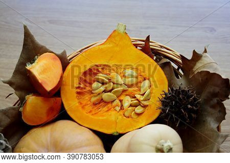 Hokkaido Pumpkin Cutaway. Autumn Still Life With Pumpkins And Persimmon.