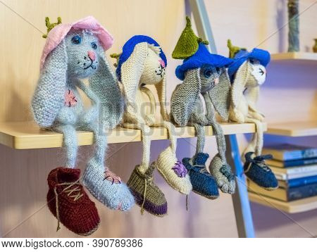 Many Hand Made Knitted Sad Hares. Amigurumi Rabbit. Knitted Toys