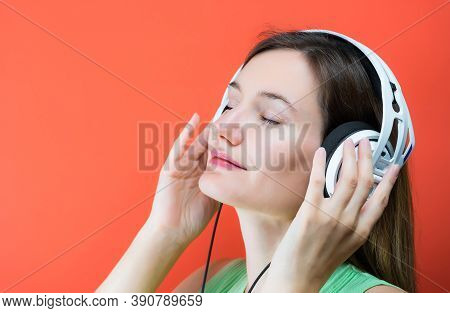 Young Dj Woman With White Headphones. Musical Hifi Headphones