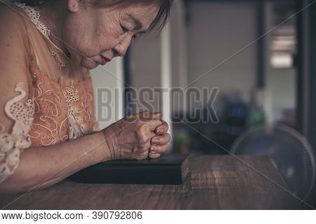 At Church. Hope For Peace And Free From Coronavirus,  Asian Senier Female Wear Medical Mask Praying,
