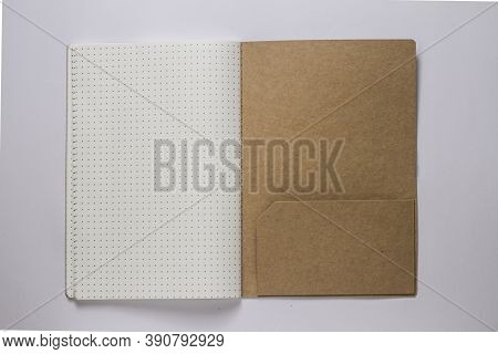 A Dotted Book On White Background Stock Photo