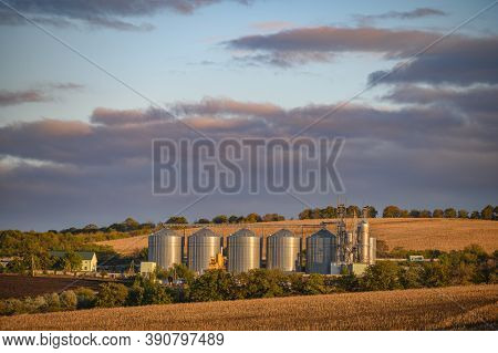 Rogojeni railway station, Floresti, Moldova, October 2020: Grain storage silos. Shiny metal tanks for grain, granary with equipment managed for receiving, cleaning, drying, grain handling, storage and