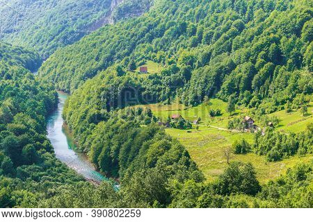 Houses By Tara River In Mountains Of Durmitor, Montenegro