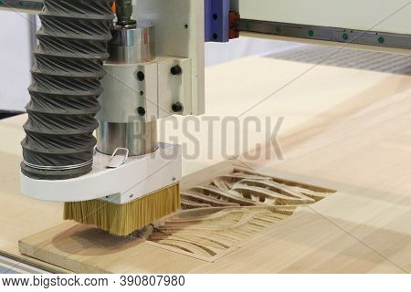 Milling A Wooden Board. Processing Of Wood Panels On Cnc Coordinate Milling Woodworking Machines. Cn