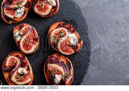 Toast With Caramelized Onions, Goat Cheese, Cream Cheese, Thyme, Honey And Figs. Figs With Nut. Blue