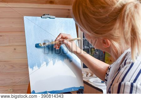 Girl Artist Paints A Picture On Canvas At Home With Oil Paints At Home. Lessons At Painting Studio.