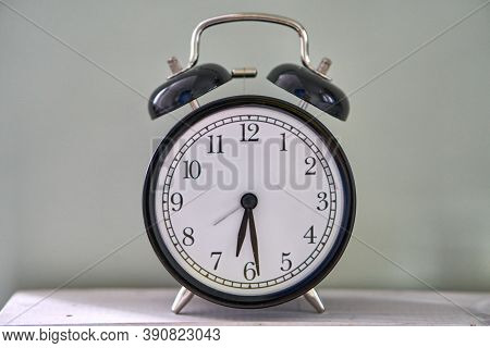 Half Past Five. The Time Is 5:30 Am Or Pm. Retro Clock Isolated Wooden Table.