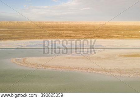 Salt Lake With Wide Flatlands Background.