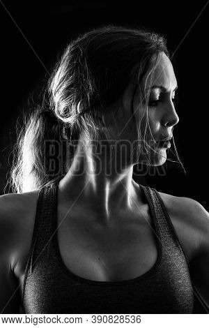 Slim Sexy Athletic Woman On Black Background