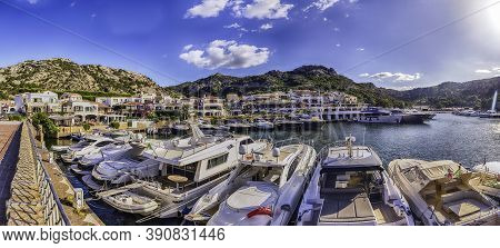View Of The Harbor With Luxury Yachts Of Poltu Quatu, Sardinia, Italy. This Picturesque Town Is A Re