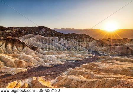Badlands View From Zabriskie Point In Death Valley National Park At Sunset, California