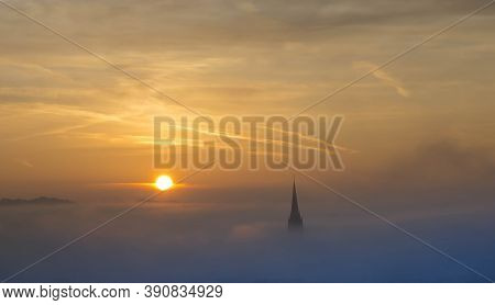 Church Of The Sacred Heart Of Jesus Surrounded By Fog And Clouds, In Graz, Styria Region, Austria, A
