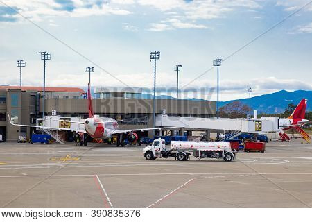 Palmira, Colombia - October, 2020: Fuel Truck Parking Near Airplane For Fueling At The Alfonso Bonil