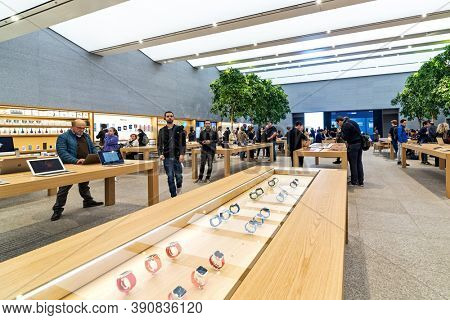 MILAN, ITALY - OCTOBER 22, 2018: People inside Apple Store - new retail store with modern design, opened in Milan on July 26, 2018 at Piazza Liberty.